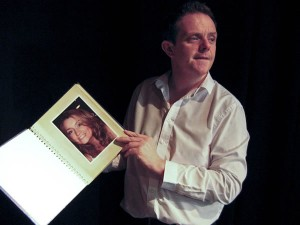 Liam Fox as Frederick Clegg showing his album of Miranda